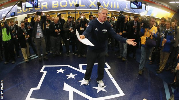 Head coach Pete Carroll of the Seattle Seahawks gives his team a speech in the locker room after the Super Bowl XLVIII