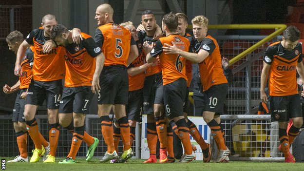 Dundee United players celebrate Mario Bilate's late strike against Motherwell.