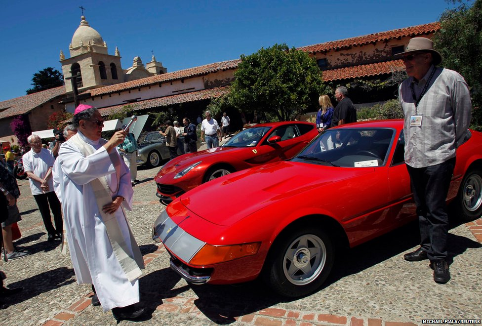 Bishop of the Diocese of Monterey Richard Garcia blesses a 1971 Ferrari 365 GTB