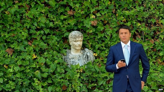 Italian Prime Minister Matteo Renzi waits for the arrival of EU Commission President Jose Manuel Barroso in Rome - 4 July 2014