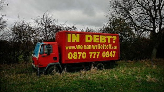 A old advertises the services of a loan company promising to write off personal financial debts next to the main M1 motorway in 2007