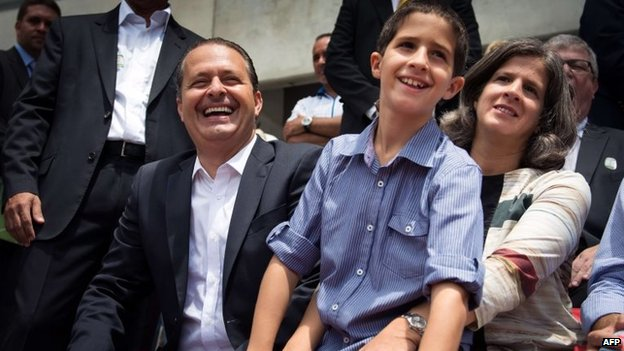 Picture taken on 14 April 2013 showing Eduardo Campos with his son Jose Henrique and his wife Renata