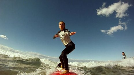 girl standing up on surf board