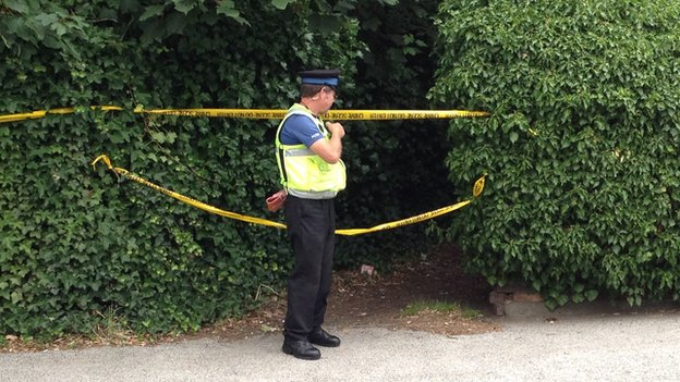 A PCSO at the scene of the investigation