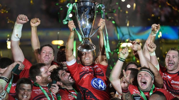 Toulon's Jonny Wilkinson lifts the trophy after winning the Heineken Cup