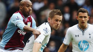 Gylfi Sigurdsson battles for the ball with Fabian Delph