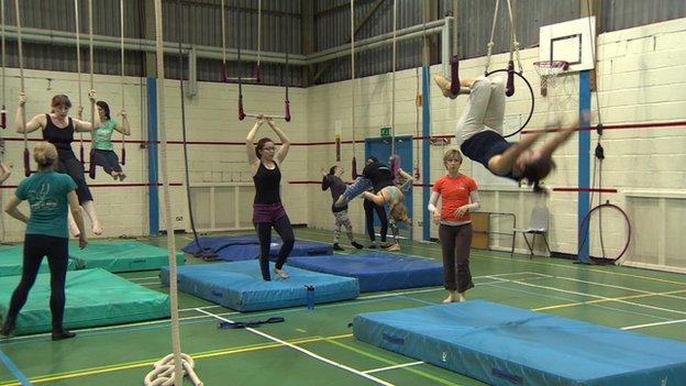 trapeze class with several women training