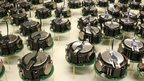 Swarming robots shuffle into shape