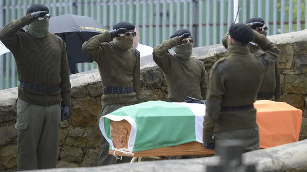 A number of men dressed in military-style clothing attended Tony Catney's funeral