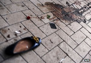 An abandoned shoe beside bloodstains in Donetsk, 14 August