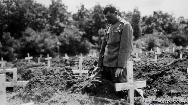 A soldier paying his respects to a fallen comrade in Belgrade.