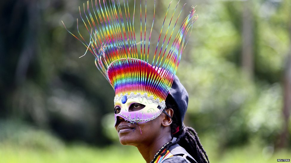 A woman wears a mask while celebrating the annulment of an anti-homosexuality law by Uganda's constitutional court in Entebbe on 9 August 2014