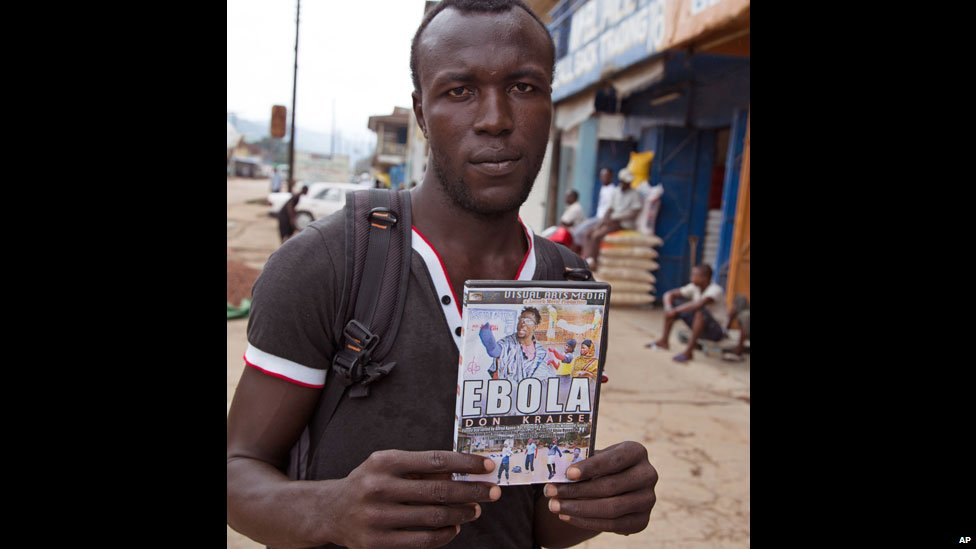 In this photo taken on 12 August 2014, a trader sells a recently produced film called Ebola Don Kraise (Ebola's gone crazy) in the streets of Kenema, Sierra Leone