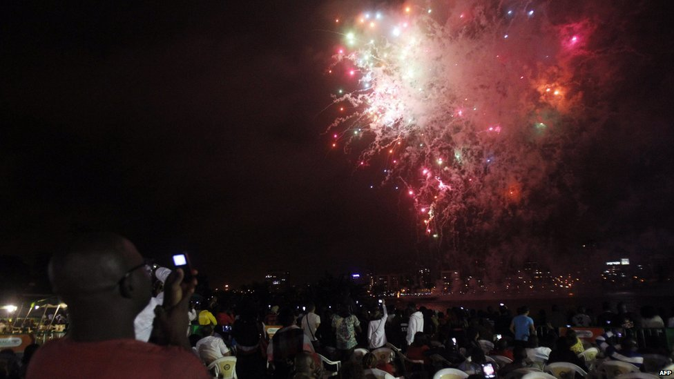 Fireworks commemorating Ivory Coast's  54th Independence Day are seen over lagoon Ebrie in Abidjan on 9 August 2014