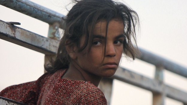 Yazidi girl in refugee convoy