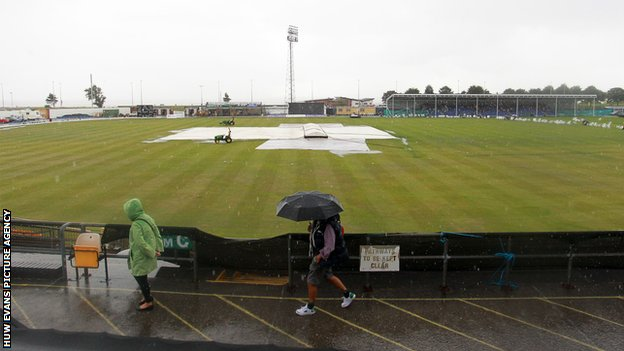 Spectators faced a bleak scene when heavy rain fell during the middle of the match