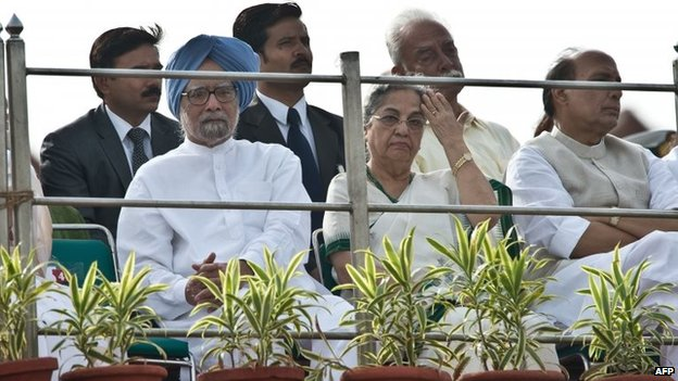 Former PM Manmohan Singh listens to a speech by Modi at the Red Fort to mark the country's 68th Independence Day in New Delhi on August 15, 2014