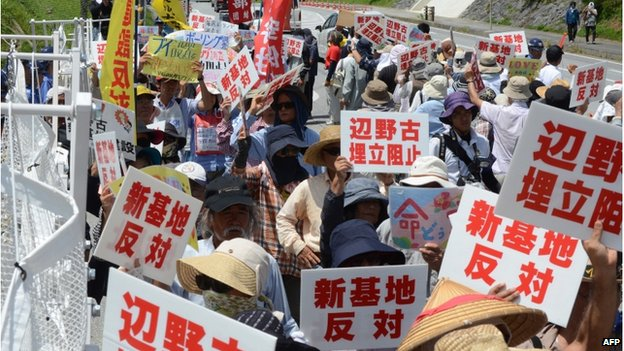 Protesters stage a rally at the gates of Camp Schwab, near the site of the new US military runways in Nago, Okinawa prefecture on 14 August 2014
