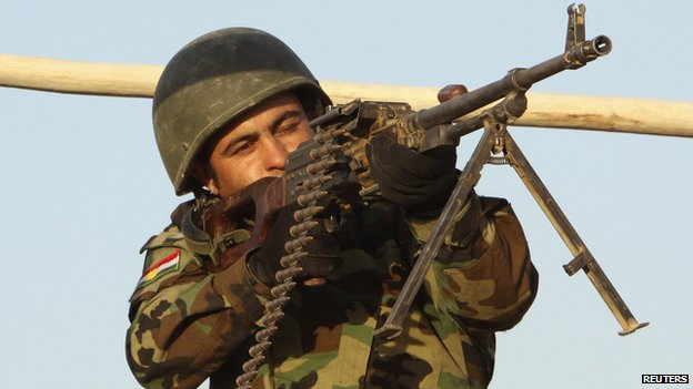 A Kurdish Peshmerga fighter takes position on the frontline in Khazer August 14, 2014