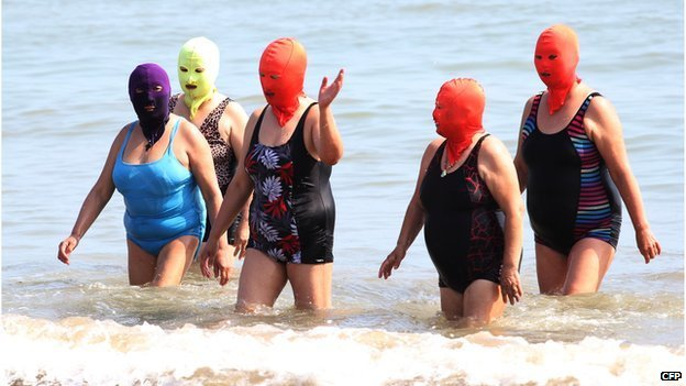 Picture of women at Qingdao wearing Face-kinis.