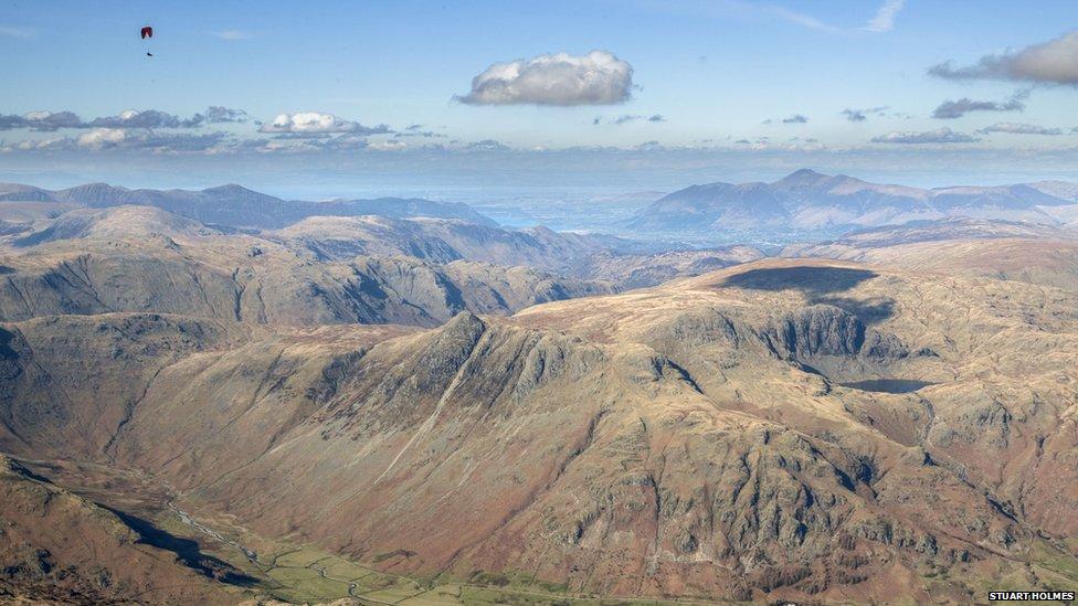 A paraglider over Langdale