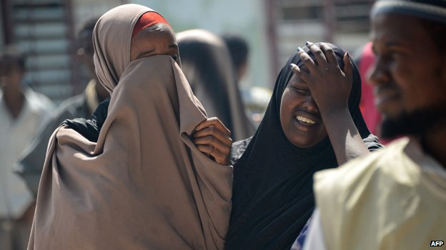 Two women mourn the death of a relative killed in an al-Shabab bomb attack earlier this month