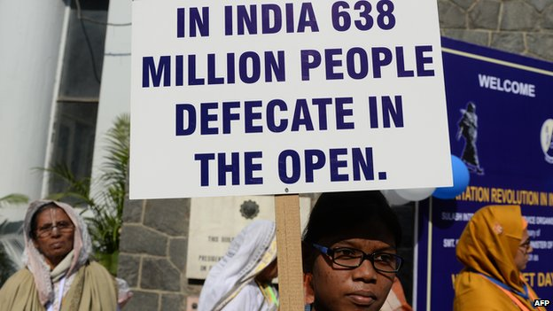 A participant holds up a placard during a function to mark World Toilet Day In Delhi on November 19, 2013.