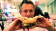 Michael Mosley eating a burger