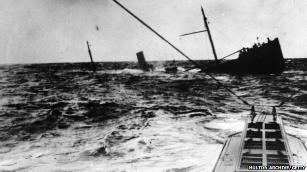 A British merchant vessel in the North Sea, sunk by a U-Boat which has surfaced, circa 1916.