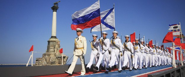 Russian sailors march during celebrations to mark Navy Day in the Crimean port of Sevastopol, 27 July, 2014