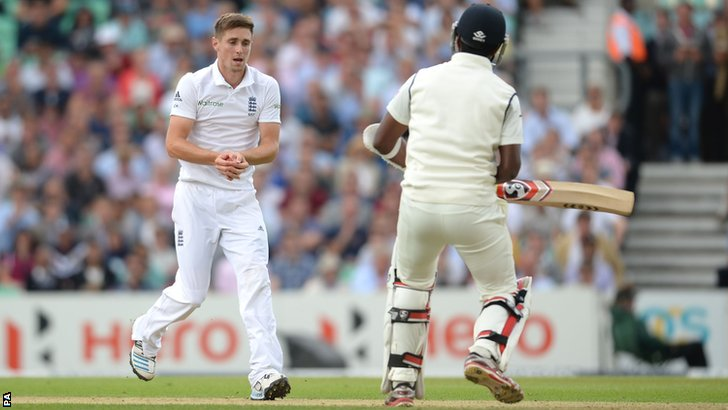 England's Chris Woakes catches Varun Aaron off his own bowling