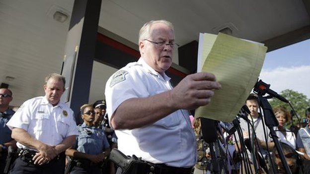 Ferguson Police Chief Thomas Jackson reads his notes during a press conference.