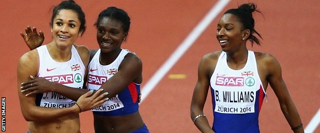 Silver medallist Jodie Williams is congratulated by Dina Asher-Smith and Bianca Williams