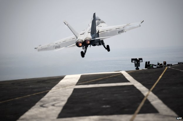 A US warplane takes off from the USS George HW Bush in the Gulf, 15 August