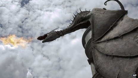 A dragon breathes fire from atop Gringnotts Bank during a preview of Diagon Alley at the Wizarding World of Harry Potter at Universal Orlando