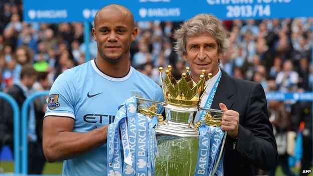 Vincent Kompany and Manuel Pellegrini with Premier League trophy