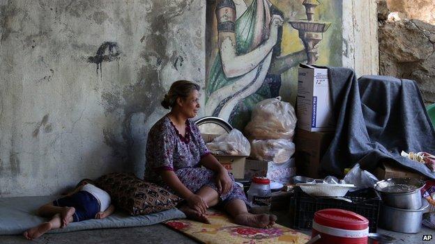 A Yazidi woman and child