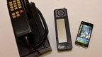 The IBM Simon next to a modern smartphone
