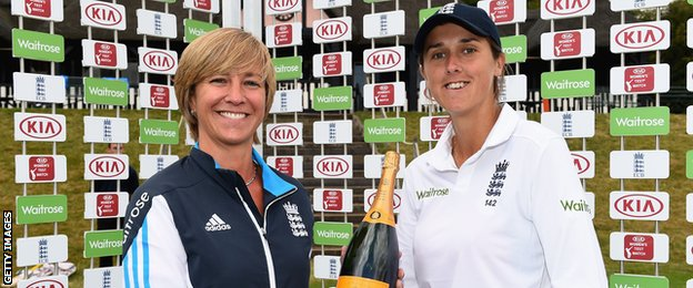 Jenny Gunn is awarded the player of the match champagne by England head of women's cricket Clare Connor