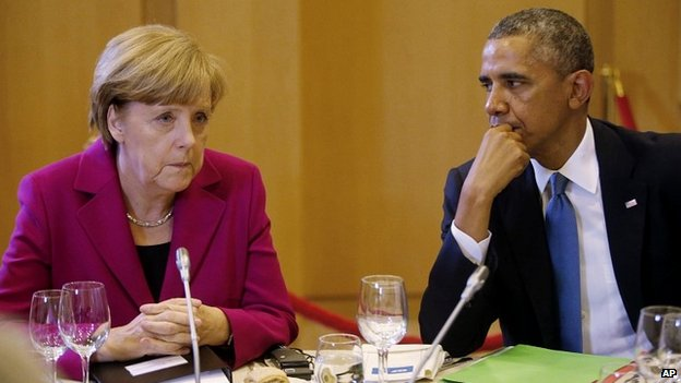 US President Barack Obama with German Chancellor Angela Merkel at a G7 dinner in Brussels, Belgium - 4 June 2014
