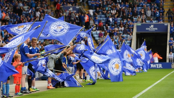 Young fans fly Leicester City flags prior to the Barclays Premier League match