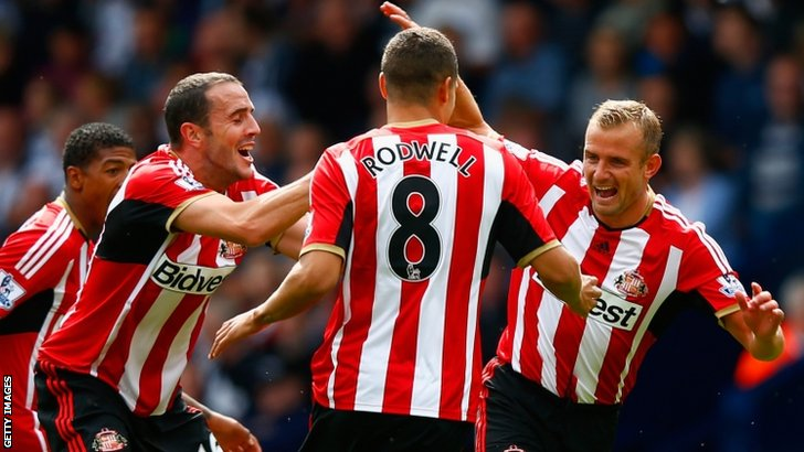 Lee Cattermole of Sunderland (R) celebrates