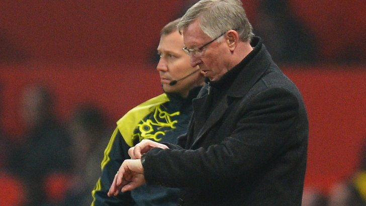 Sir Alex Ferguson looks at his watch