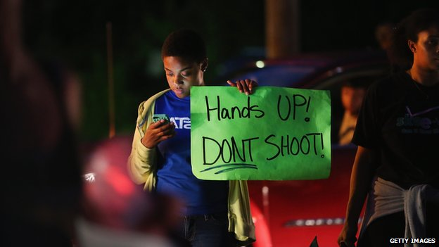Demonstrators gather along West Florissant Avenue to protest the shooting and death of Michael Brown on August 15, 2014 in Ferguson, Missouri