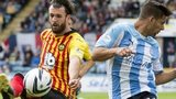Partick Thistle's Daniel Seaborne clears under pressure from Luka Tankulic (right) of Dundee.