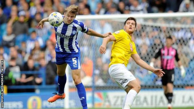 Sheffield Wednesday's Glenn Loovens heads clear
