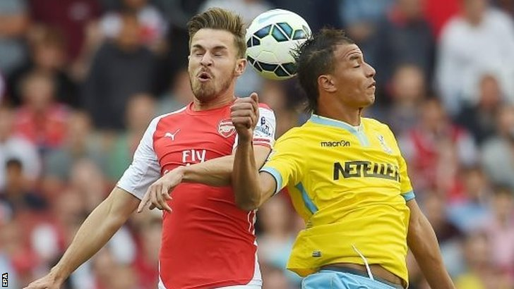Aaron Ramsey goes for a header
