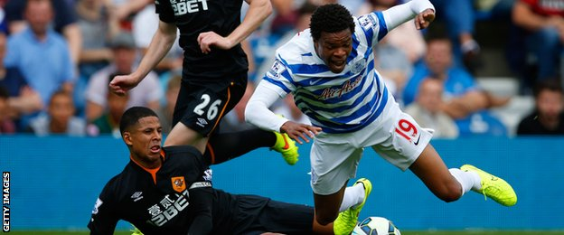 Loic Remy is tackled by Curtis Davies