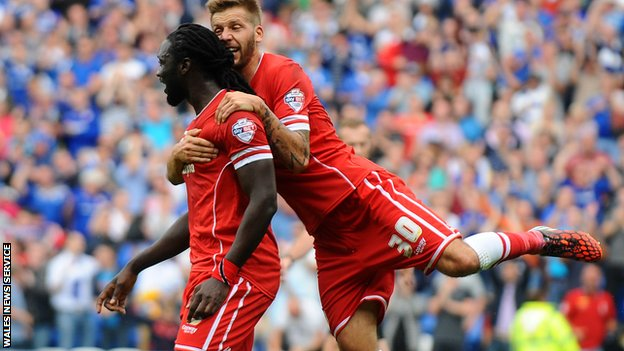 Kenwyne Jones and Guido Burgstaller celebrate