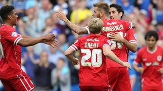 Cardiff City players celebrate Peter Whittingham's goal